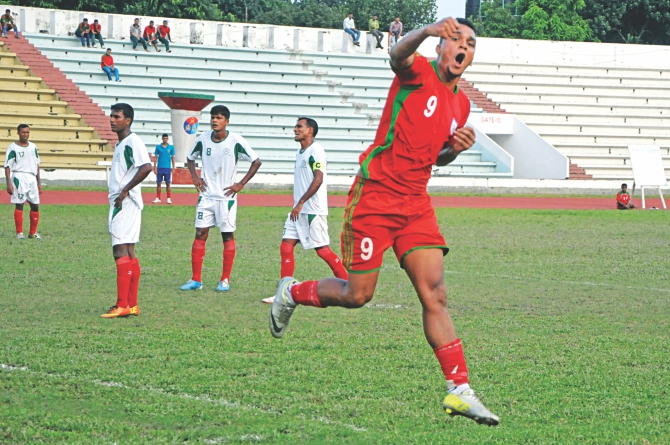 Bangladesh U-23 national team's striker Wahed Ahmed celebrates after scoring the opening goal against Bangladesh Army at the Army Stadium in Banani yesterday. PHOTO: STAR