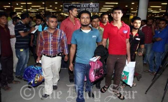 In this August 4, 2013 photo, 17 Bangladeshi workers arrive at Shahjalal International Airport after languishing in an Egyptian jail for their illegal entry into the country.