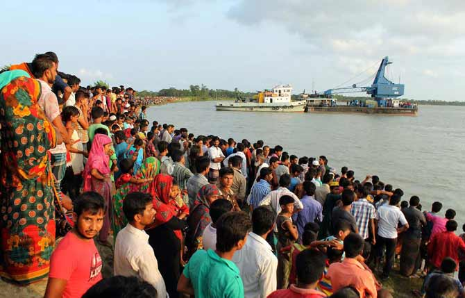 Relatives and villagers gather on the bank of Golachipa river in Patuakhali where a launch capsized Saturday afternoon. Photo: Star