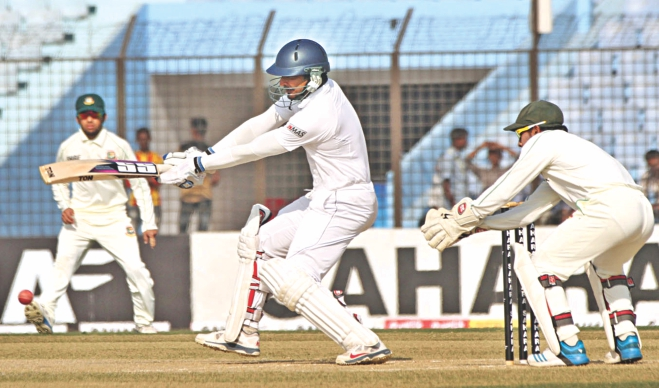 Sri Lanka batsman Kumar Sangakkara plays a square-cut during the first day of the second Test against Bangladesh at the Zahur Ahmed Chowdhury Stadium in Chittagong yesterday. The left-hander remained unbeaten on 160 as the visitors posted 314 for 5 at stumps. PHOTO: ANURUP KANTI DAS