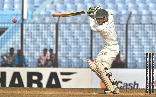 Young Bangladesh batsman Mominul Haque plays an attractive back-foot square drive on way to scoring a match-saving hundred on the fifth day of the second Test against Sri Lanka at Zohur Ahmed Chowdhury Stadium in Chittagong yesterday. Photo: Anurup Kanti Das