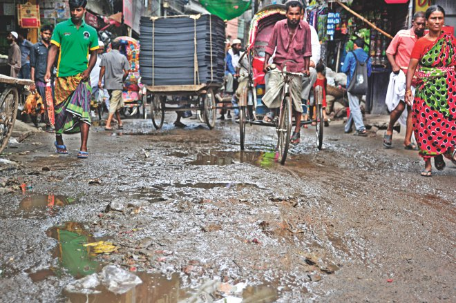 Haji Osman Gani Road in Alu Bazar of Old Dhaka has been in this sorry state for the last two years causing immense sufferings to commuters. The photo was taken yesterday. Photo: Star