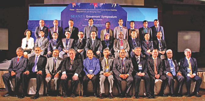 Bangladesh Bank Governor Atiur Rahman poses with other central bankers of different countries at the 29th SEANZA Governors' Symposium held at Radisson Hotel in Dhaka yesterday. Photo: BB