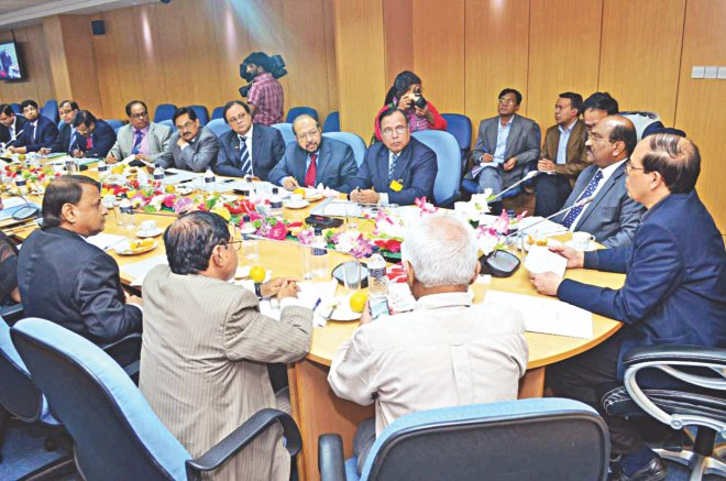 Atiur Rahman, governor of Bangladesh Bank, briefs chief executives of banks on random anti-money laundering inspections by the Financial Action Task Force, at the central bank's headquarters in Dhaka yesterday.  Photo: BB