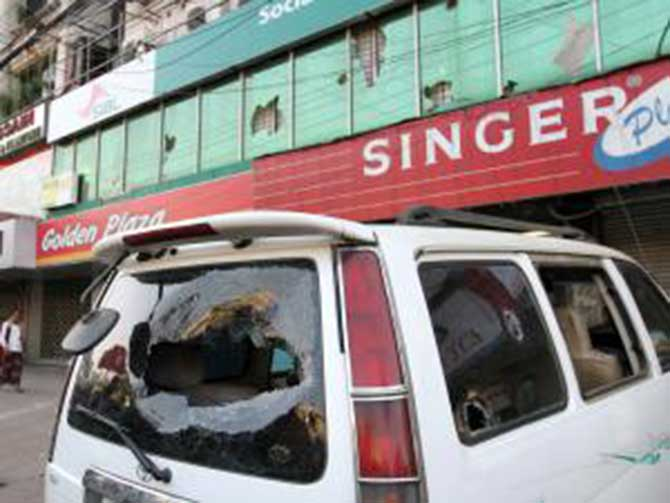 A vandalised microbus stand still after two factions of Bangadesh Chhatra League clashed in Chittagong today. Photo: Prothom Alo