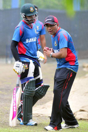 Bangladesh coach Chandika Hathurusingha (R) gives Shamsur Rahman a few front-foot batting tips during the national team's net session at the Mirpur Indoor Stadium yesterday. PHOTO: STAR