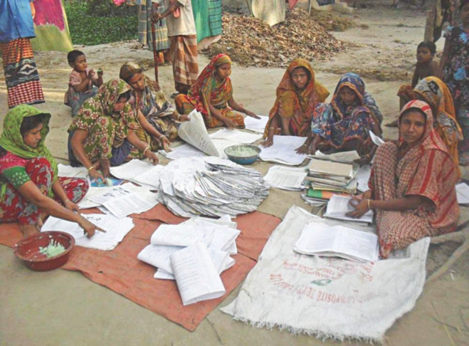 Once struggling to manage two square meals a day, these women at Telikhali village in Patuakhali Sadar upazila now earn a modest amount by making and selling paper bags. PHOTO: STAR