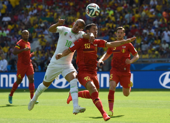 Algeria's forward Sofiane Feghouli (C-L) and Belgium's forward Eden Hazard (C-R) vie for the ball during a Group H football match between Belgium and Algeria at the Mineirao Stadium in Belo Horizonte during the 2014 FIFA World Cup on June 17, 2014. Photo: AFP/Getty Images