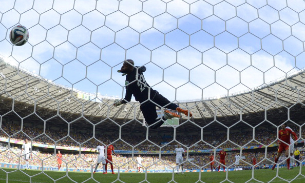 Algeria's goalkeeper Rais Mbohli (C) fails to save a ball shot by Belgium's midfielder Marouane Fellaini (R) during a Group H football match between Belgium and Algeria at the Mineirao Stadium in Belo Horizonte during the 2014 FIFA World Cup on June 17, 2014. Photo: AFP/Getty Images