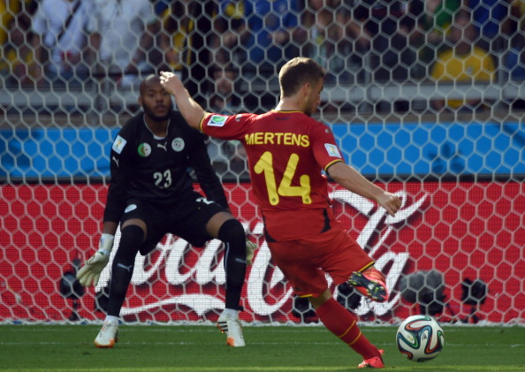 Belgium's forward Dries Mertens (R) shoots to score against Algeria's goalkeeper Rais Mbohli during a Group H football match between Belgium and Algeria at the Mineirao Stadium in Belo Horizonte during the 2014 FIFA World Cup on June 17, 2014. Photo: AFP/Getty Images