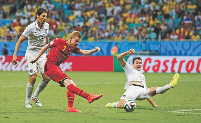 Belgium midfielder Kevin De Bruyne finally breaks the stubborn USA defence with his low right-footer in an entertaining Round of 16 match that exploded in the last ten minutes of a 120-minute thriller at Fonte Nova Arena in Salvador yesterday. Belgium won 2-1. Photo: AFP