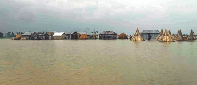 Homes go under water at Belka of Sundarganj upazila in Gaibandha as floods grip the north. The photo was taken yesterday. Photo: Star