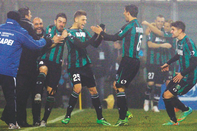 Sassuolo striker Domenico Berardi (C) celebrates after scoring his fourth goal against AC Milan during their Serie A match at the Mapei stadium in Reggio Emilia on Sunday. PHOTO: REUTERS