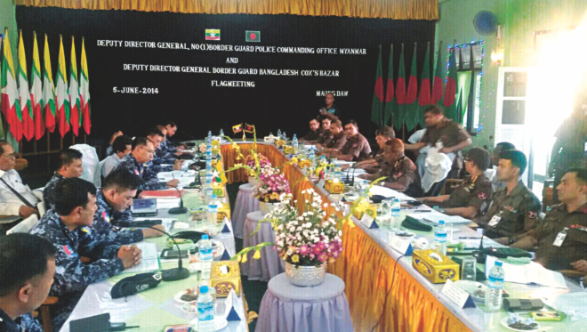 Officials of Border Guard Bangladesh, in the right row, and Myanmar's Border Guard Police (BGP) at a deputy director general-level (DDG) flag meeting in Myanmar's Maungdaw yesterday, as tension flared on the border after a BGB nayek, Mizanur Rahman, was shot dead by BGP in an unprovoked attack on May 28. The two sides were led by Cox's Bazar Sector Commander Col Khandker Farid Hasan and Maungdaw's Director Police Brig Thin Ko Ko. Photo: BGB