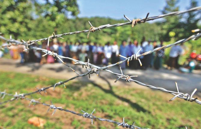 This barbed-wire fence has been put up around 34 acres of land to build the BGB headquarters in Bandarban. People of two Marma villages are dependant on the land. Photo: Anurup Kanti Das
