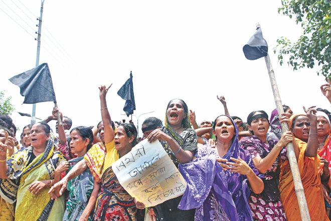 Biharis bring out a procession in front of Kurmitola Bihari camp in Mirpur, demanding justice for the killing of 10 people in the Saturday morning arson.  Photo: Palash Khan