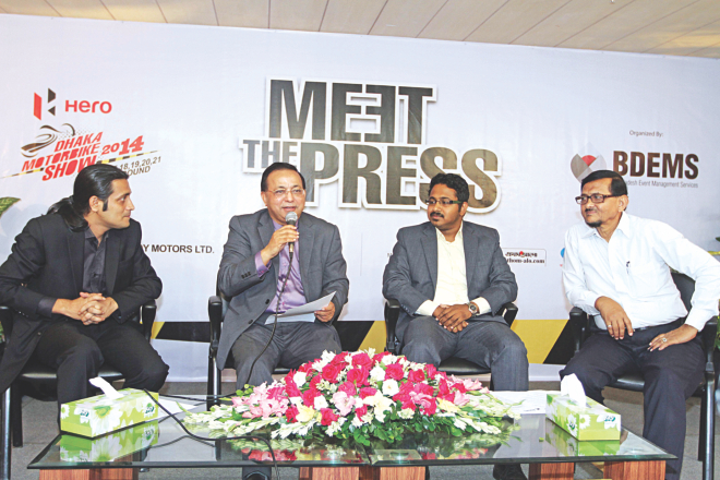 Abdul Matlub Ahmad, chairman of Nitol Niloy Group, and Nilangshu Nandi, country manager of Hero MotoCorp, attend a press conference at The Daily Star Centre in the capital yesterday to announce a mega motorbike show to be held in Dhaka in September. Photo: Star