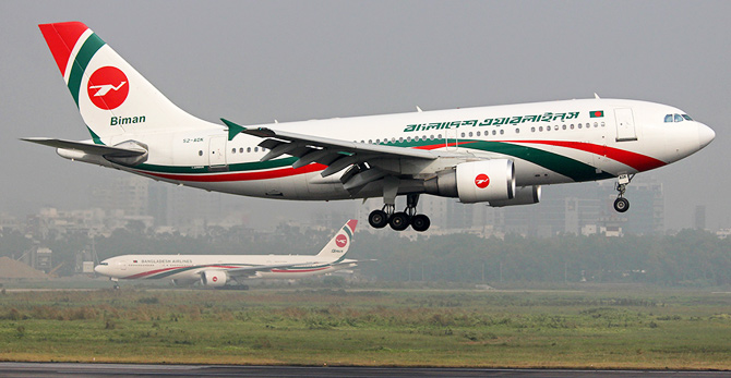 This photo taken from Wikipedia shows an Airbus landing at Shahjalal International Airport while a Boeing is on short hold, both wearing the latest livery.