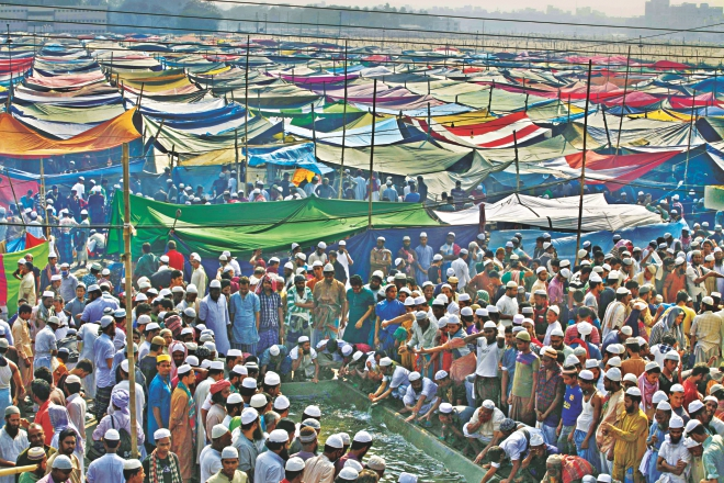 Devotees gather at a reservoir at the Biswa Ijtema ground for ablutions before Zohr prayers yesterday, the second day of the first part of the Ijtema on the Turag in Tongi. The Akheri Munajat (final prayers) will be held today seeking divine blessings of Almighty Allah. Photo: Rashed Shumon