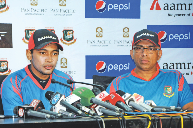 Bangladesh captain Mushfiqur Rahim (L) briefs the media on their four-week camp for the upcoming tour of the West Indies as coach Chandika Hathurusingha listens in Mirpur on Sunday. PHOTO: STAR