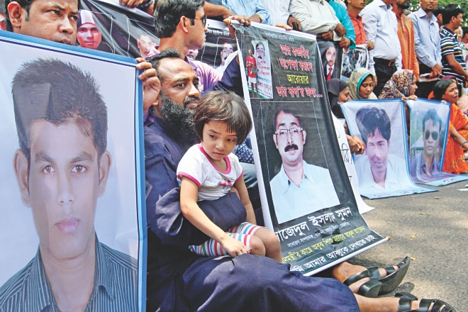 Family members of eight people who had disappeared, including local leader of Ward-38 unit of BNP Sajedul Islam Sumon, form a human chain in front of the Jatiya Press Club yesterday demanding the return of their loved ones. The families claimed that people in Rab uniform had picked them up five months ago. Photo: Anisur Rahman