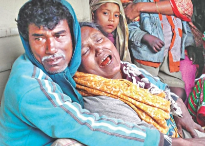A mother cries her eyes out yesterday for her son who went missing as a boat caught fire and sank in the river Surma in Sunamganj on Monday night.  Photo: Star