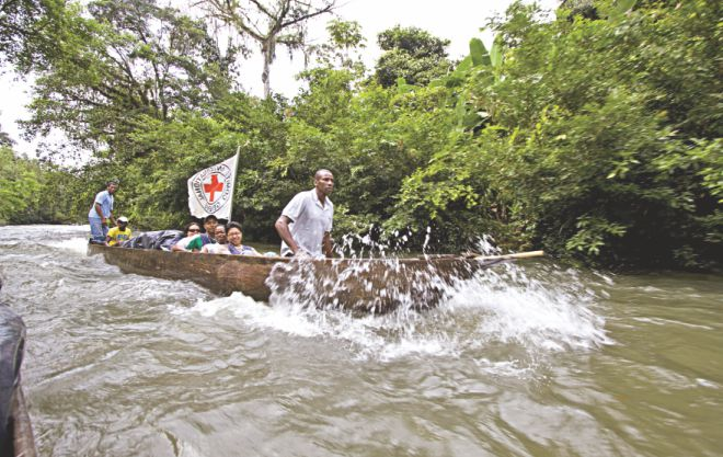 ICRC doctors and nurses go by boat on the Espi River: Colombia, 2010.