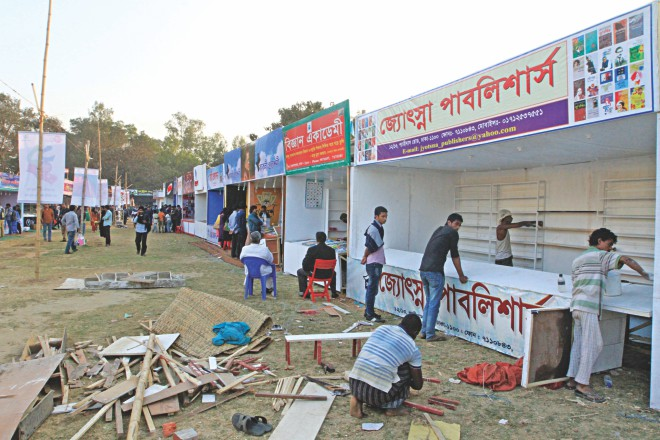 Although Amar Ekushey Grantha Mela 2014 was inaugurated on Saturday, some of these stalls falling in the portion of the fair in the capital's Suhrawardy Udyan had not still completed decorations, let alone start selling books. The photo was taken yesterday. Photo: Palash Khan