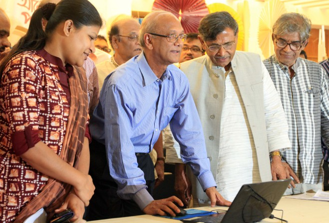 "Education Minister Nurul Islam Nahid inaugurates the online book reading programme, ""Alor Pathshala"" (school of enlightenment), of Bishwo Shahitto Kendro at the institution in the capital yesterday as BSK founder Prof Abdullah Abu Sayeed, second from right, along with guests looks on. Photo: Star"