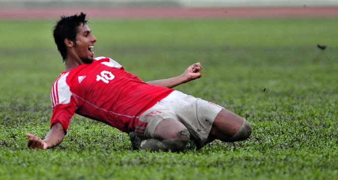 Bangladesh U-23 midfielder Sohel Rana celebrates his winning goal against their visiting Nepalese counterparts in the first of the two-match SS Steel International Friendly Series at the Army Stadium in Banani yesterday. PHOTO: Firoz Ahmed