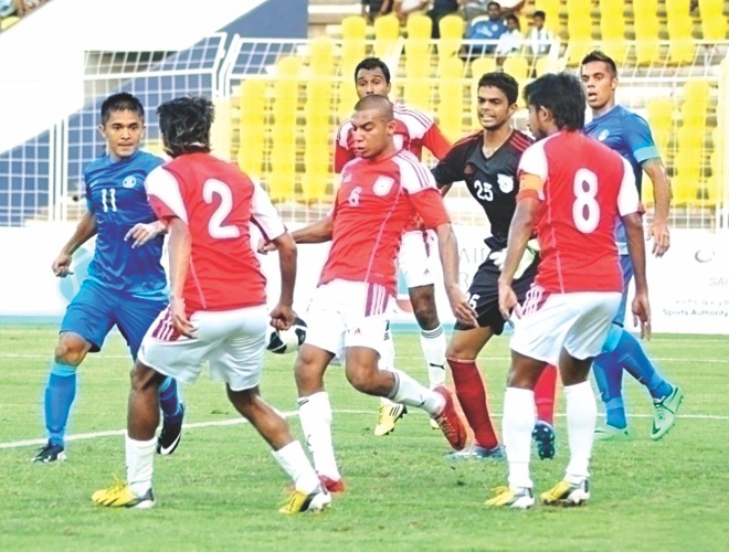 Bangladesh defenders scramble clear an Indian attack during their FIFA International Friendly at the Jawaharlal Nehru Stadium in Margao, Goa yesterday. PHOTO:  INTERNET