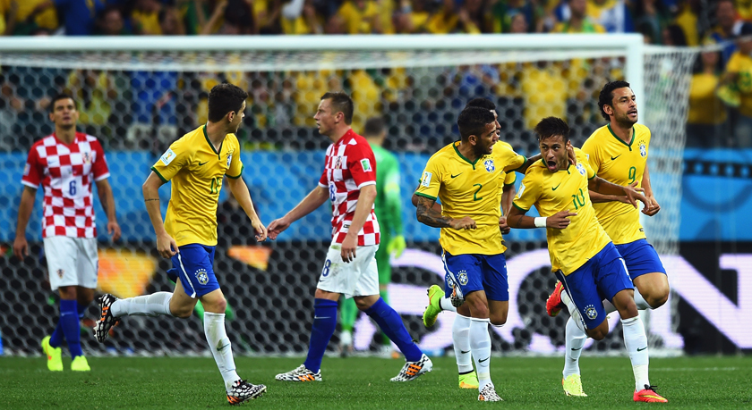 Neymar of Brazil (2nd R) celebrates with Dani Alves and Fred after a goal in the first half during the 2014 FIFA World Cup Brazil Group A match between Brazil and Croatia at Arena de Sao Paulo on June 12, 2014 in Sao Paulo, Brazil. Photo: Getty Images