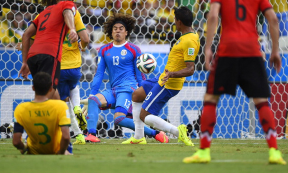 Mexico's goalkeeper Guillermo Ochoa (C) kicks the ball during a Group A football match between Brazil and Mexico in the Castelao Stadium in Fortaleza during the 2014 FIFA World Cup. Photo: AFP/Getty Images