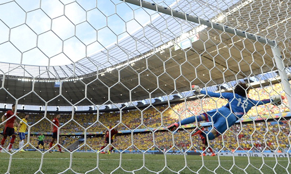 Mexico's goalkeeper Guillermo Ochoa dives for the ball during a Group A football match between Brazil and Mexico in the Castelao Stadium in Fortaleza during the 2014 FIFA World Cup. Photo: AFP/Getty Images