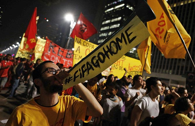 A demonstrator blows a horn during a protest against the 2014 World Cup, in Sao Paulo May 15, 2014. Photo: Reuters