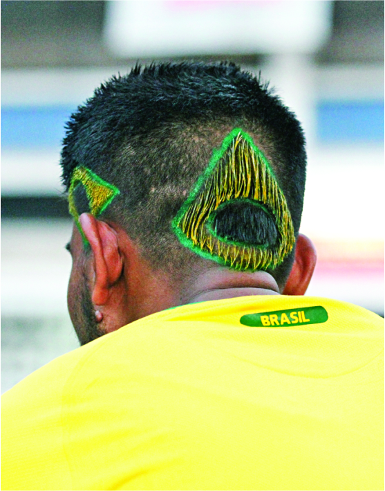 Brazil on his head and in his heart. Photo: Prabir Das