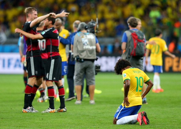 Willian of Brazil reacts after the 1-7 defeat in the 2014 FIFA World Cup Brazil Semi Final match between Brazil and Germany at Estadio Mineirao on July 8, 2014 in Belo Horizonte, Brazil. Photo: Getty Images