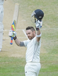 New Zealand captain Brendon McCullum salutes the Basin Reserve crowd at Wellington after completing his triple hundred, the first by a New Zealand batsman, against India on the fifth and final day of the second Test yesterday. Photo: AFP