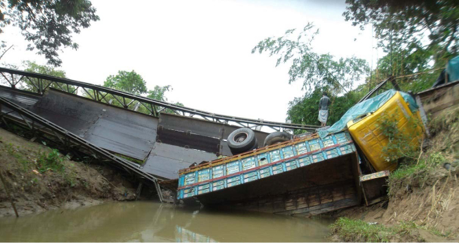 This bailey bridge near 31 BGB Battalion headquarters in Naikkhongchhari upazila under Bandarban district collapsed under the pressure of an overloaded truck on July 23, leaving road communication between Naikkhongchhari and Ramu upazilas snapped since then.  PHOTO: STAR