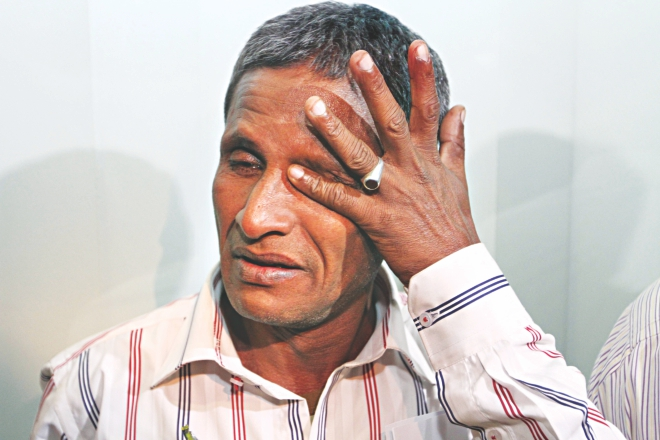 Sailor Golam Mostafa is inconsolable, as his tears make it obvious, after landing at Shahjalal International Airport. Golam and six other sailors returned home yesterday after being held captive by Somali pirates for three and a half years. Photo: Palash Khan