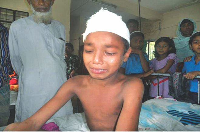 Torture victim Shimul, now undergoing treatment at Aditmari Upazila Health Complex in Lalmonirhat district, breaks down in tears as he narrates his torment to The Daily Star correspondent yesterday.  PHOTO: STAR