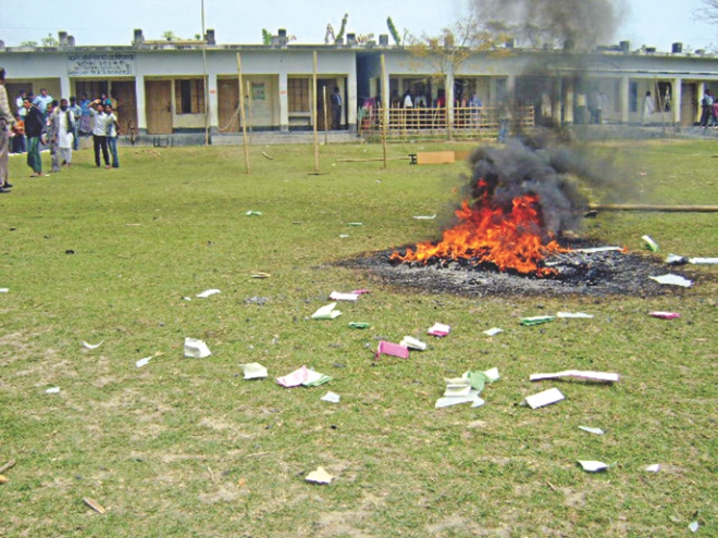 Two ballot boxes burn on the Satshi Govt Primary School ground following the incident. Photo: Star