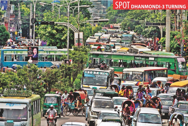 Buses from Jhigatola take turn en route to Elephant Road, creating traffic chaos at Dhanmondi-3 turning in the capital around 2:00pm yesterday.  Photo: Anisur Rahman