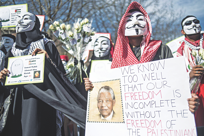 In celebration of the Mandela Day, protesters gather outside the Israeli embassy's office in Johannesburg on Friday to show their support for the Palestinian people and demand the expulsion of the Israeli ambassador in South Africa.  Photo: AFP