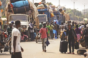 Muslim civilians prepare to board trucks in the P12 district of Bangui to flee the Central African Republic capital yesterday.  Photo: AFP