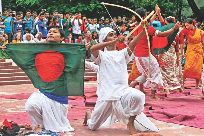 "Indigenous people performing at the Central Shaheed Minar yesterday in observance of International Day of the World's Indigenous Peoples. Bangladesh Adivasi Forum organised the event where almost every banner and festoon had the word ""adivasi"" on it.  Photo: Anisur Rahman"