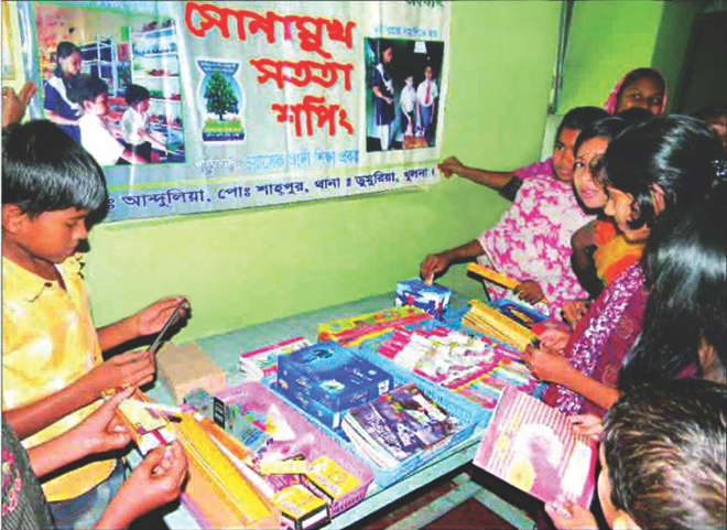 Children shop stationeries from the shopkeeper-less store at Little Flower Kindergarten School in Dumuria of Khulna.  Photo: Star