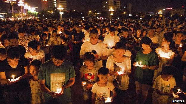 Residents attended a candlelight vigil for victims of the factory explosion in Kunshan on Saturday. Photo: BBC/Reuters