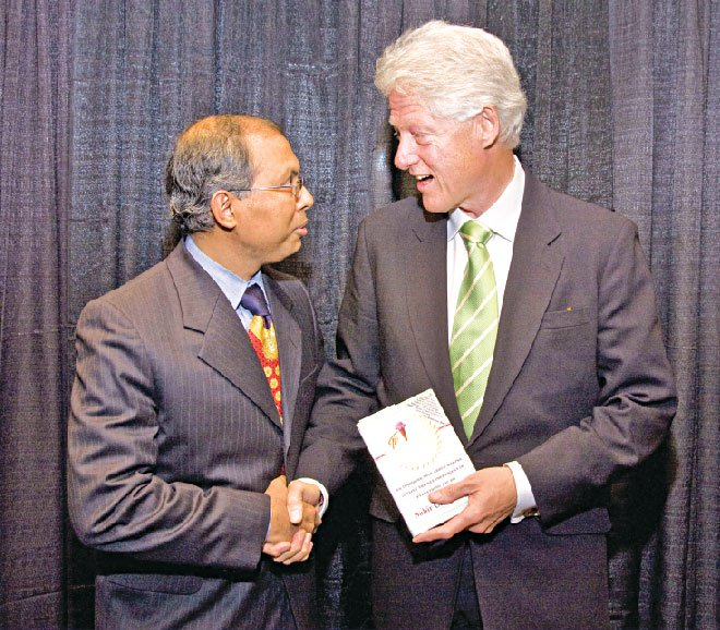Presenting his book 'The Ice Cream Maker' to US President Clinton.