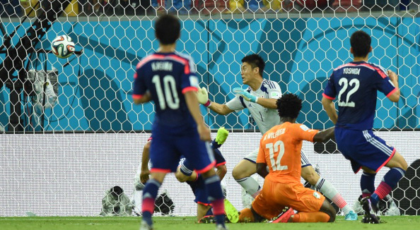 Ivory Coast's forward Wilfried Bony (C) heads the ball to score past Japan's goalkeeper Eiji Kawashima during a Group C football match between Ivory Coast and Japan at the Pernambuco Arena in Recife during the 2014 FIFA World Cup on June 14, 2014. Photo: AFP/Getty Images